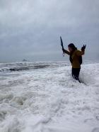 Harpo testing out the neoprene socks at high tide